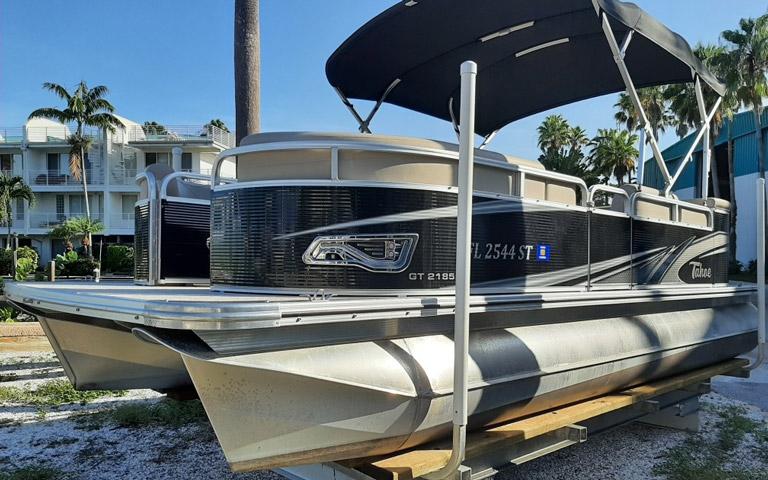 Pontoon rental boat sitting on dry dock